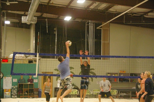 Indoor Volleyball League Net Action